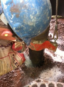 Matt pouring in hole plug to protect bore hole.