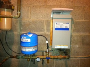 Constant pressure system. Allows even water pressure taking up less space in utility room